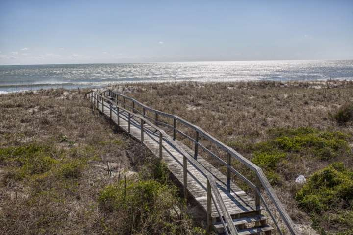 About 100 steps to the beach on your own private boardwalk