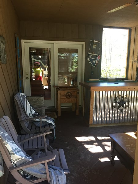 Front private screened porch with bar and swings.  Perfect for entertaining.