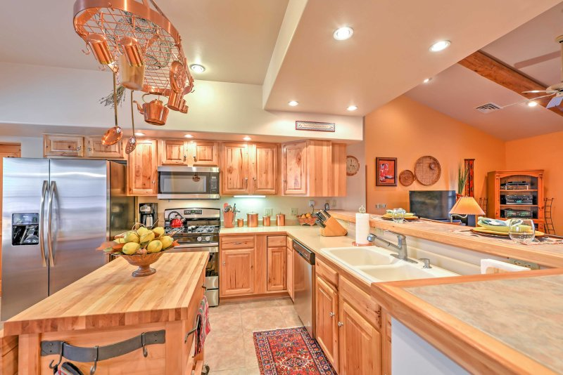 Easily cook dinners for the group  with stainless steel appliances and spacious counters.