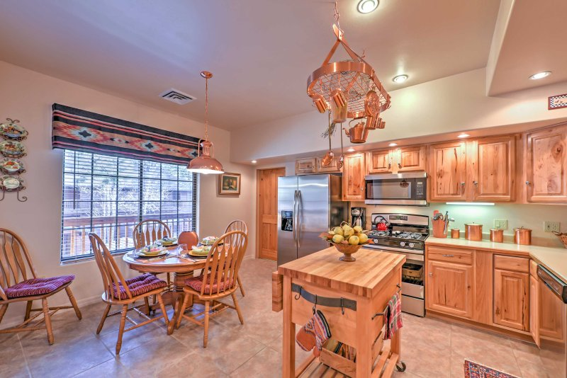 Copper accents throughout the kitchen help to create a high-quality workspace.