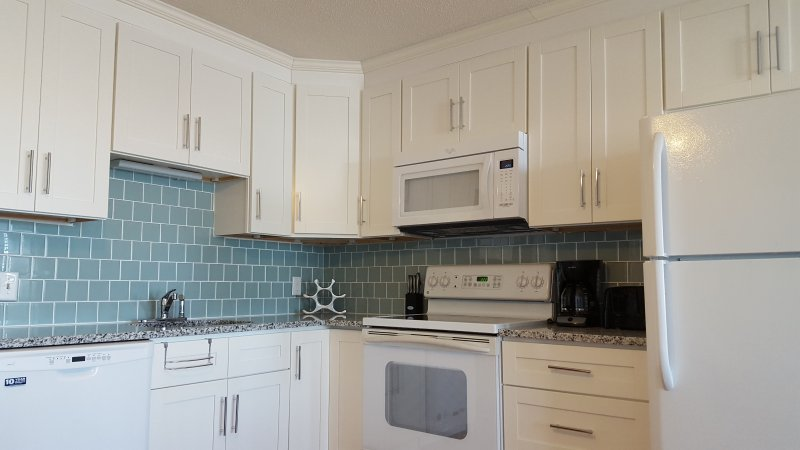 Updated kitchen with new cabinets, counters, dishwasher, and microwave.  Fully equipped.