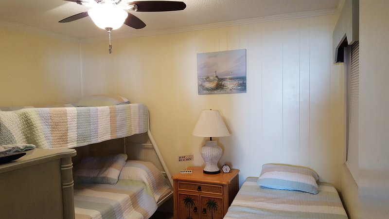 The second bedroom sleeps 4.  Full under twin bunk with 2nd twin.  Cable tv and new ceiling fan.
