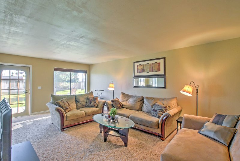 The condo boasts modern furnishings and comfortable couches!