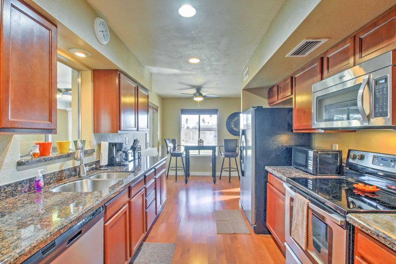 Stainless steel appliances and ample granite counters make meal prep a breeze!