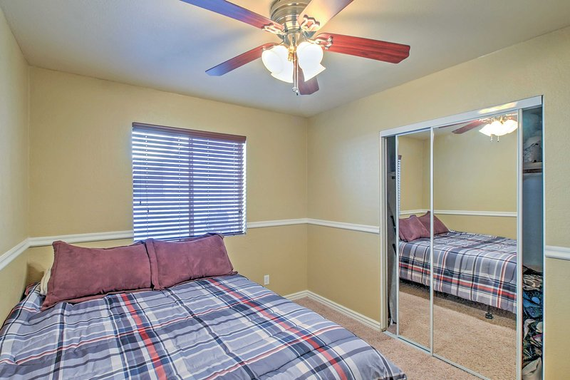 The first bedroom features a queen bed.