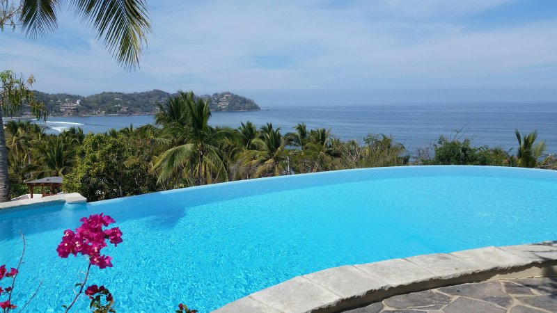This is paradise witha view of the ocean overlooking the infinity pool