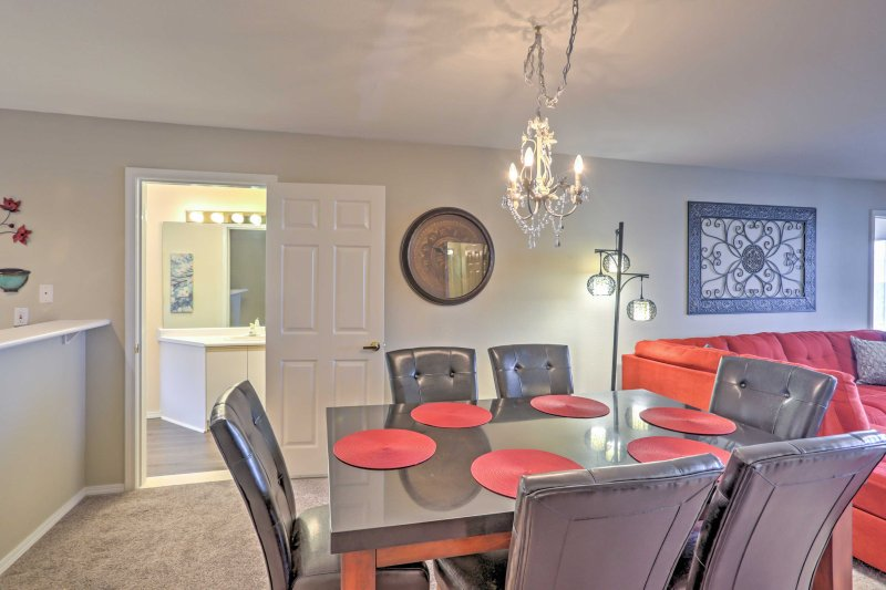 Gather around the stately dining table to enjoy your meals.