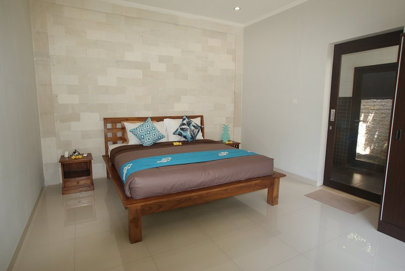 Bedroom 2 - with a spacious bathroom complete with a bathtub and outdoor shower