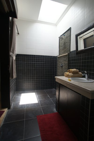 View of shower and sink in bathroom of bedroom 1