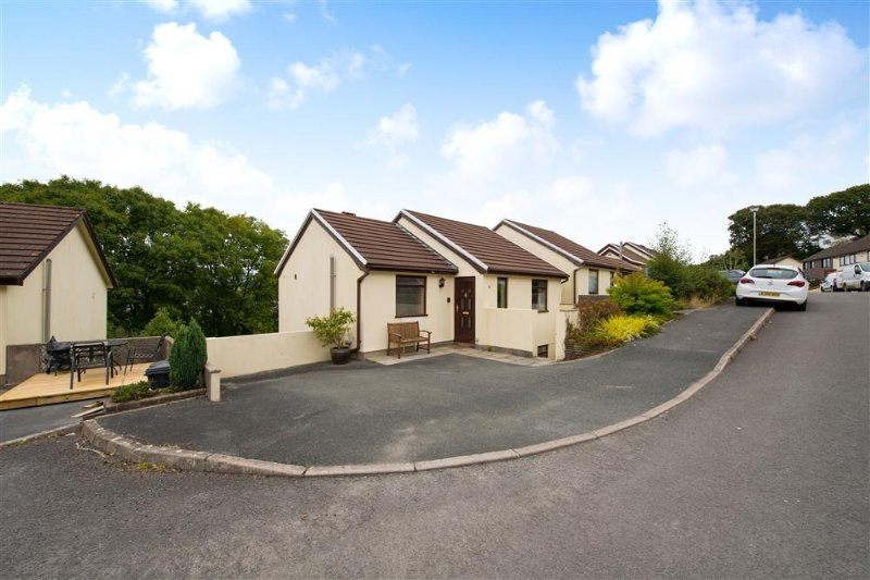 Lawnswood is a pleasant detached property with sea views