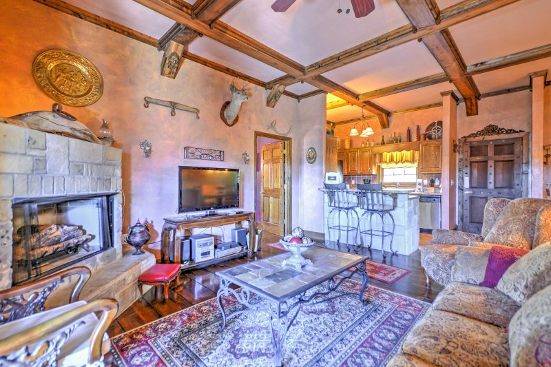 Cuddle close to the stone log gas fireplace in the living area.