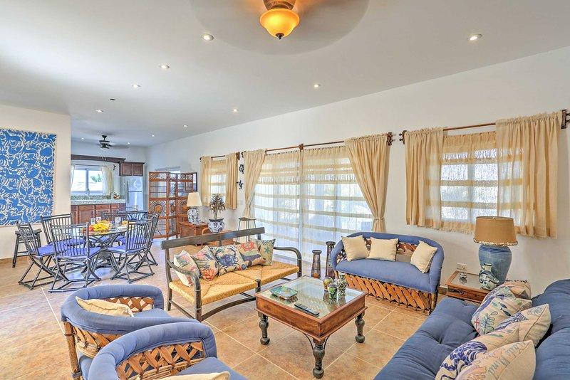 An abundance of natural light and nautical decor fill the interior.