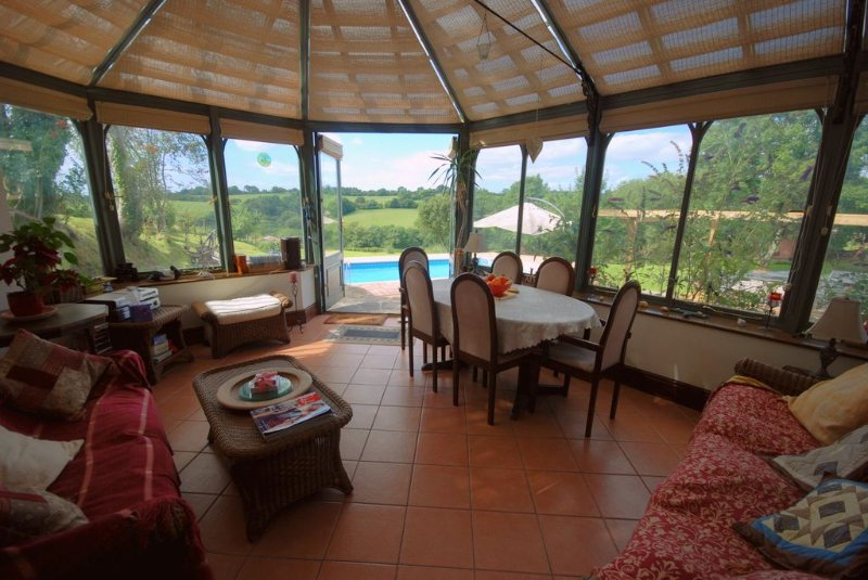 The spacious conservatory with stunning views