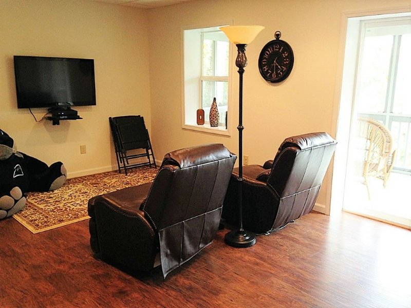 TV and Recliners in Game Room