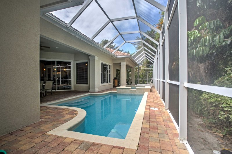 Enjoy the sparkling pool when you book this 4-bedroom vacation rental house in Marco Island.