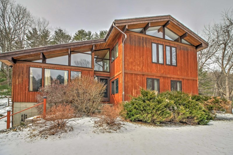 Enjoy 10 acres of secluded land when you stay at this 5-bedroom, 3.5-bathroom vacation rental home in Quechee.