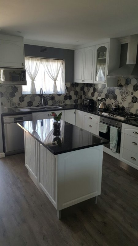 Kitchen with Gas Hob, Oven, Fridge and Dishwasher