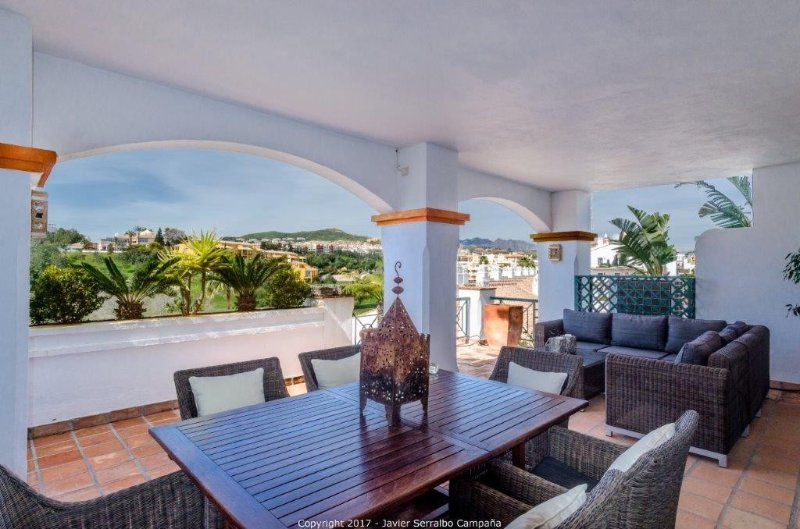 Balcony overlooking pool area and Miraflores golf. Includes dining, lounge area and barbecue