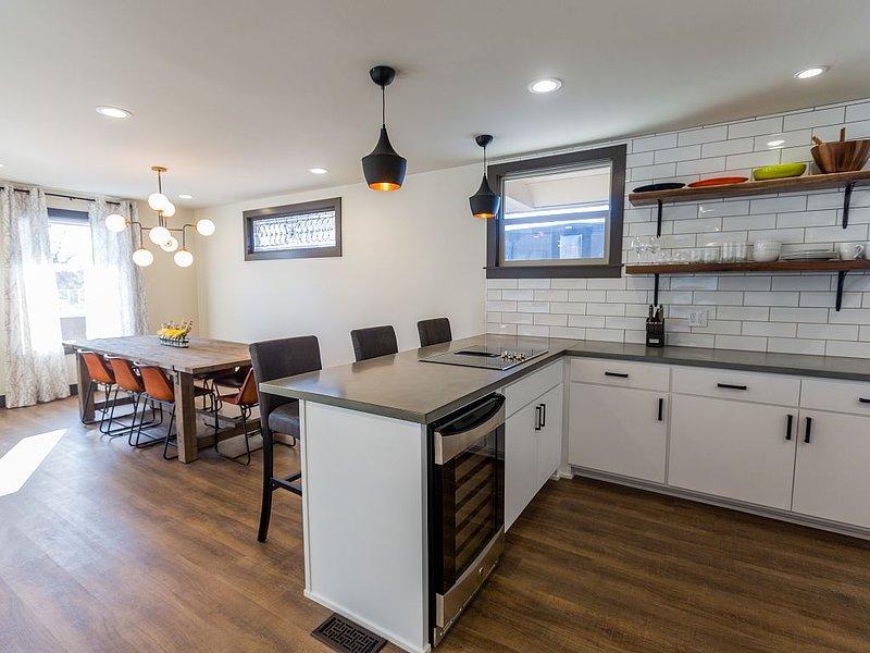 Concrete kitchen counters and wine fridge