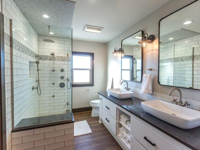 Master bath with custom tile spa shower