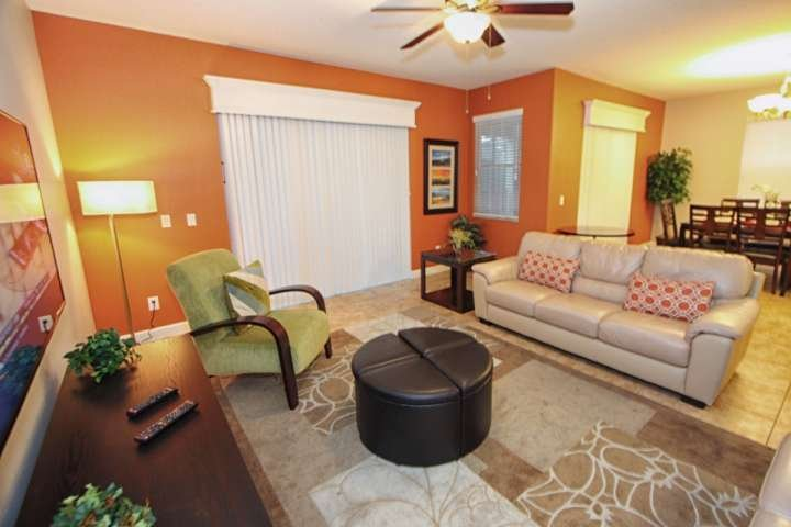 Comfortable & Modern Living Area with Wall Mounted Flat Screen TV & Pool Access