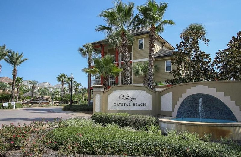 Home immediately inside popular Villages of Crystal Beach; walking distance to shopping and dining.