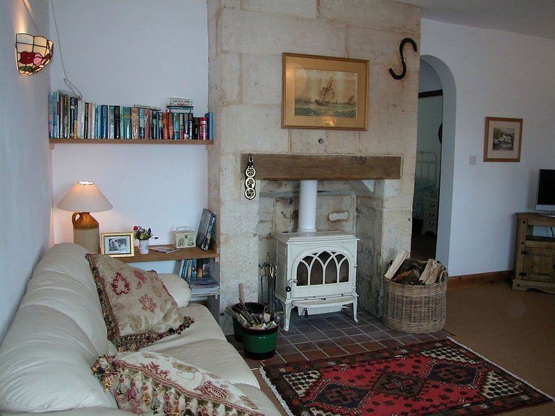 The sitting room has a woodburning stove