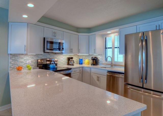 White Quartz Countertop; Coastal decor back splash; stainless st