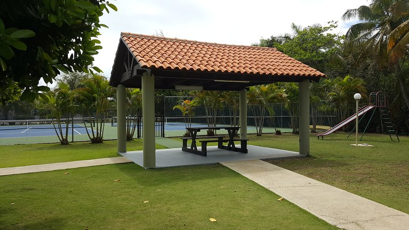 Gazebo, tennis courts and children's playground are just steps away from the apartment.