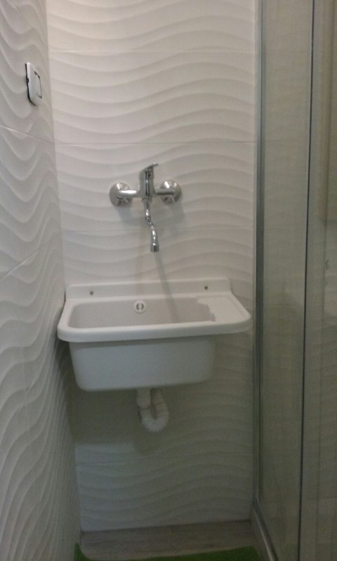 drain next to the shower