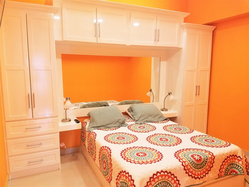 Master bedroom with ample storage and queen sized bed