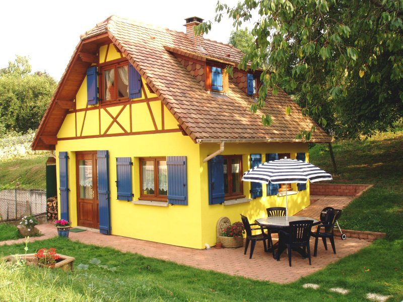Our cottage in Alsace at the foot of the orchard and one of its two terraces overlooking the orchard.
