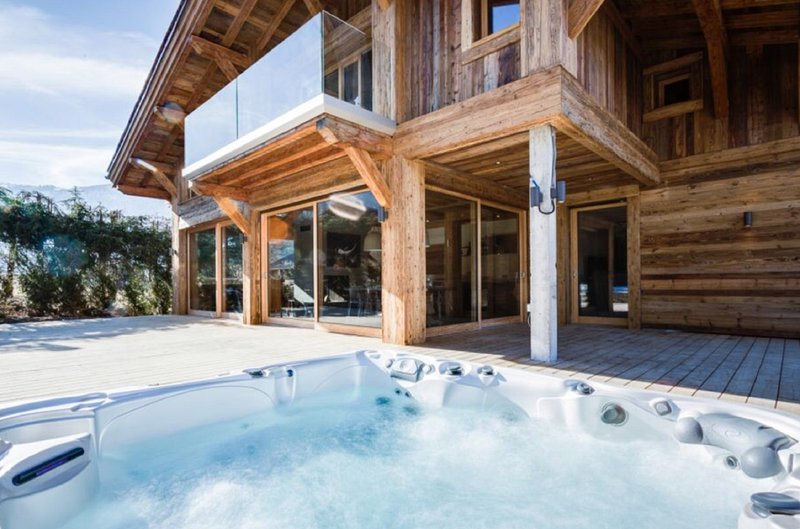 6 bedroom 6 bathroom luxury chalet with exclusive use. Jacuzzi spa in the inset terrace.