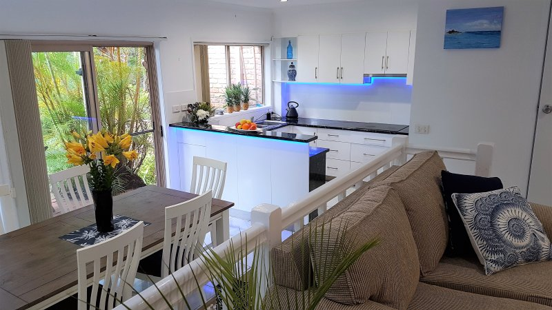 Split level lounge and dining. Large kitchen with luxury appliances, facing tropical garden terrace