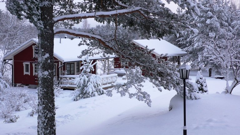Retreat cottage (left) in the winter.