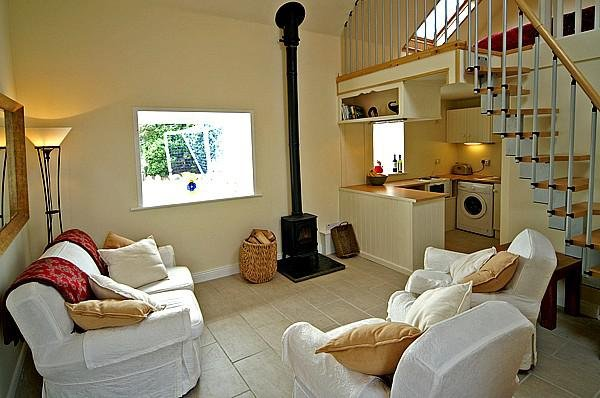 Open plan lounge with wood burning stove