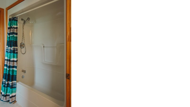 2nd floor bathroom with shower and large soaker tub