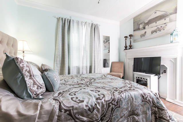 Your bedroom oasis with full functioning fireplace heater, Roku TV and door leading to private patio