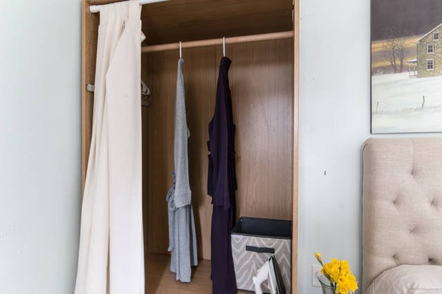 Robes and full size ironing board and iron