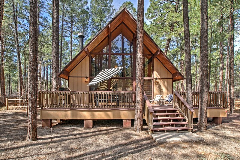 Escape to the woodlands of Pinetop when you stay at this beautiful vacation rental cabin!