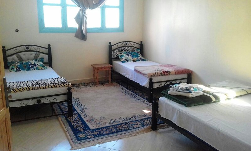 House Tafraout Azur offers five bedrooms including single, double and triple rooms with private bathroom.