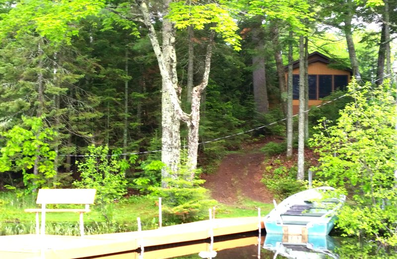 Welcome to the Bear Den Cabin  -- Lake-view of Cabin, with your Private Pier and Rowboat...