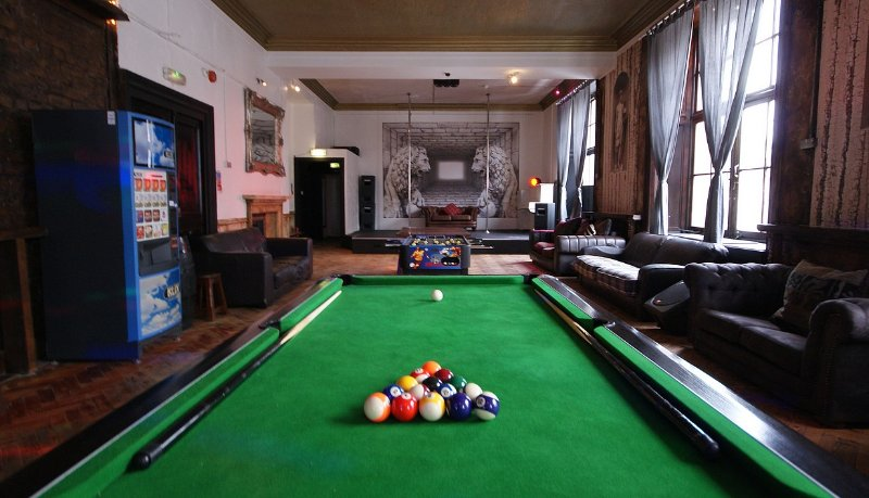 Pool table, foosball table, dancing poles, beer vending machine, tea and coffee machine, PA system.