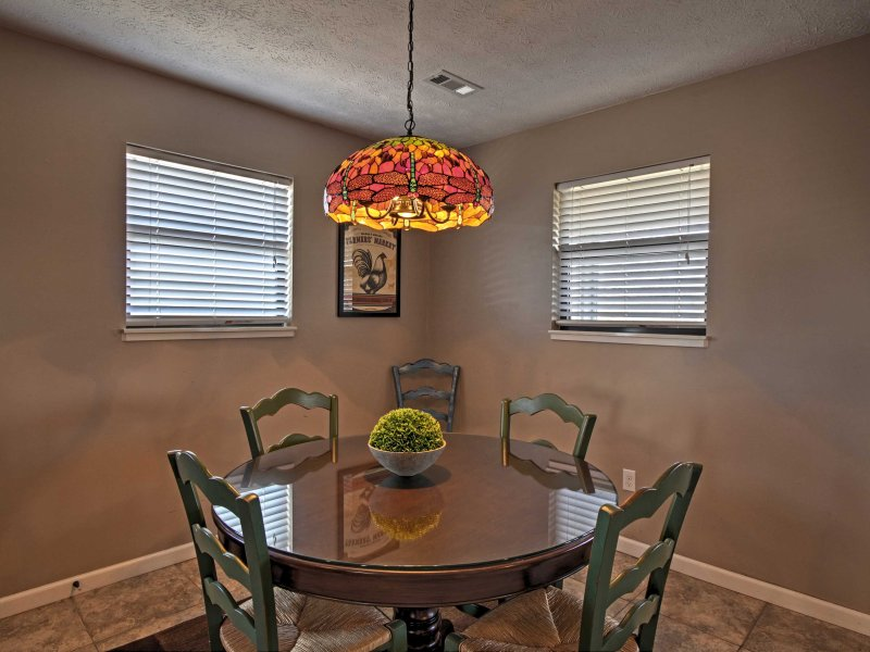 Gather with friends and family around the charming dining room table.