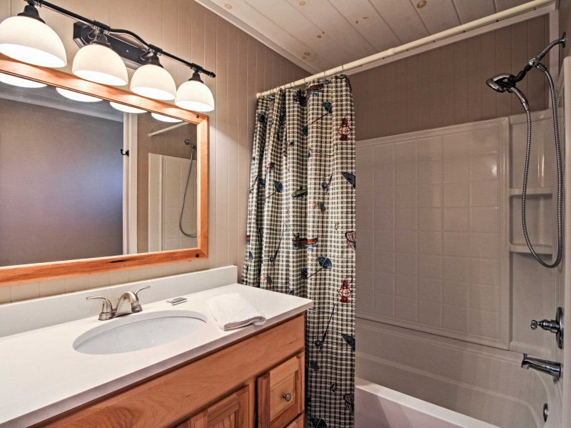 This bathroom includes a shower/tub combo.