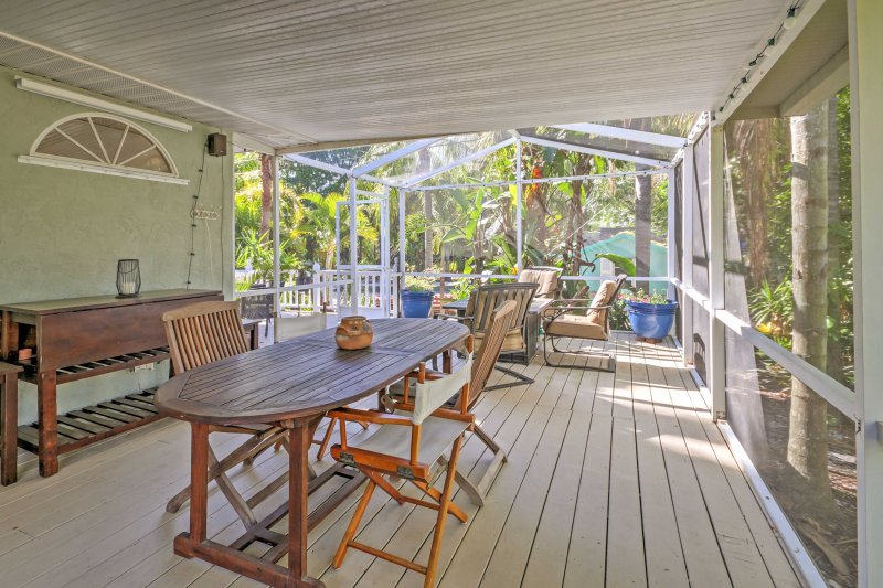 Gather around the outdoor dining table for a cup of coffee or a delicious meal.
