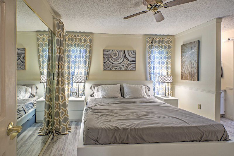 The master bedroom is equipped with a king bed and 50-inch flat-screen TV.