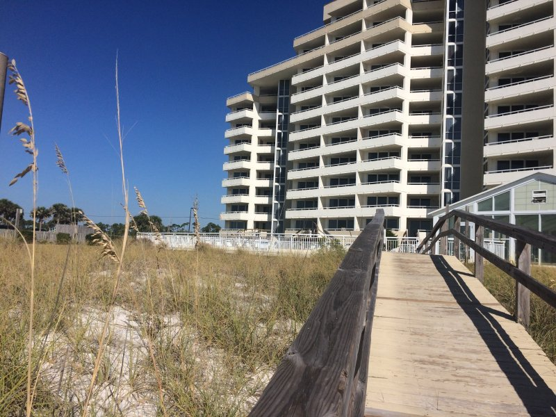 View of Condo from the Beach. Condo  is on 2nd Floor on far Left of the Building