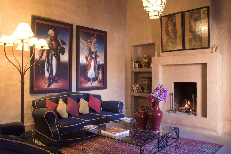 The living room with two fireplaces