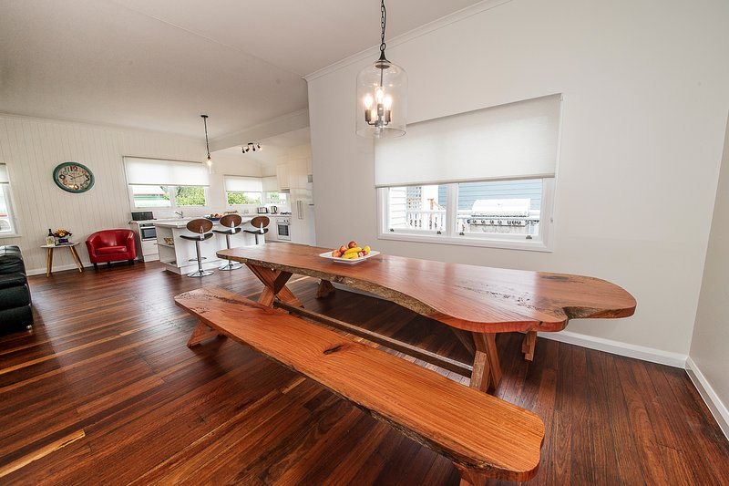 The custom built table is the centrepiece and provides comfortable seating for all guests.